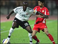 Dwight Yorke of Trinidad and Tobago and Bahrain's Rashed Abdul Rahman