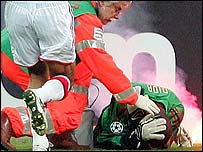 AC Milan goalkeeper Dida was struck by a flare