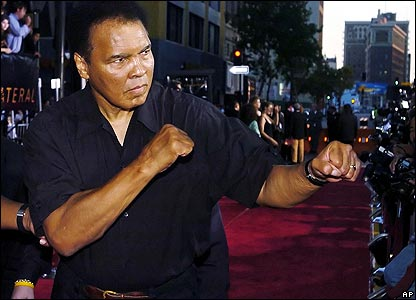 "Muhammad Ali throws a jab for photographers at the premiere of the film 'Collateral"" at the Orpheum Theater in Los Angeles, Monday, Aug 2, 2004"