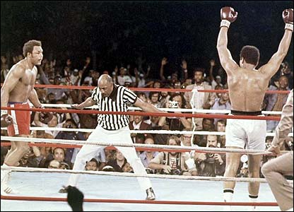 Referee Zack Clayton counts out George Foreman after Ali knocked him down in the eighth round of their Rumble in the Junge bout in Kinshasa, Zaire, October 29, 1974