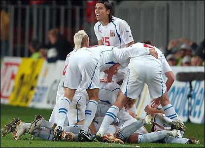 The Czechs celebrate Tomas Rosicky 's goal