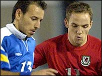Wales' David Vaughan (r) battles for possession with Michael Chrisostomos