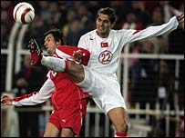 Raphael Wicky of Switzerland clashes with Turkey's Hamit Altintop