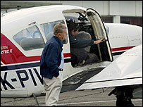 Workers inspect a chartered aircraft after it made an emergency landing at Paraparaumu Airport - 13/4/05