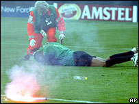 Milan keeper Dida is hit by a flare at the San Siro