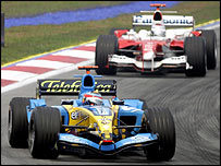 Fernando Alonso heads Jarno Trulli during