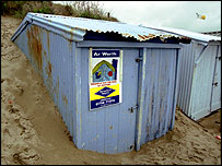 Blue corrugated iron beach hut