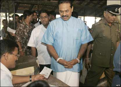 Sri Lankan Prime Minister Mahinda Rajapakse casting his vote in the election