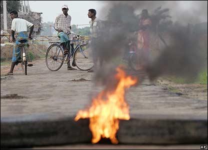 Villagers turn back at a road block in eastern Sri Lanka