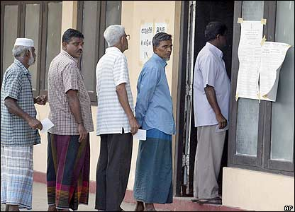 Voters stand in queue to cast their ballot in Sri Lanka