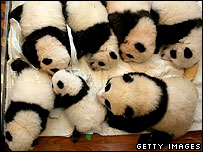 Giant panda cubs sleep at the China Wolong Giant Panda Protection and Research Centre on October 19, 2005 in Wolong of Sichuan Province, China.