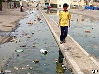 Child walking through Baghdad slum