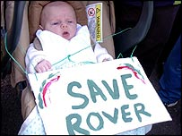 A baby with a Rover sign