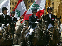 Lebanese horseriders with national flag in procession at National Unity festival
