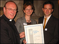 Editor Maria Balinska (middle) collecting the award with Daniel Tetlow (right)