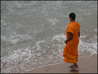 Monk on beach