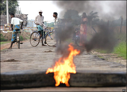 Burning barricade in Tamil Tigers' territory, Sri Lanka