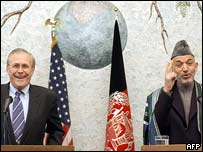 Donald Rumsfeld and Hamid Karzai in Kabul