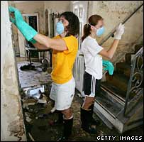New Orleans residents try to remove mould from their home