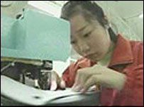 Worker in Nike contract factory in China