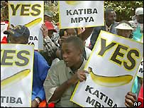 Kenyans hold up posters of a banana symbolising their support for the proposed constitution.