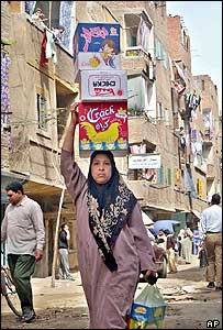 Woman carrying boxes in downtown Cairo