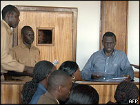 Kizza Besigye (right) in a civilian court