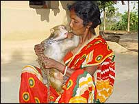 Indian woman with pet monkey