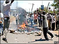Kenyans protest around a fire in Kisumu about the proposed new constitution.
