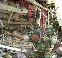 Soldier at scene of factory collapse