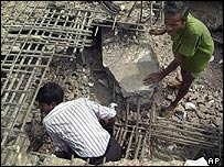 Rescue workers at factory collapse site