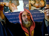 Adnan al-Rawi, member of the Sunni Committee of Muslim Scholars, shows pictures of alleged torture victims