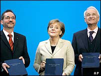 German Chancellor-designate Angela Merkel (centre) of CDU, SPD chairman Matthias Platzeck (left), CSU chairman Edmund Stoiber (right)