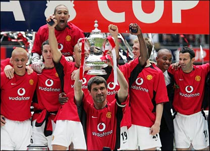 Keane lifts the FA Cup after United defeat Millwall 3-0