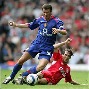 Keane is tackled by Luis Garcia at Anfield