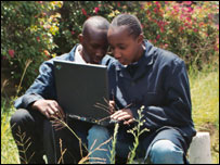 Boys using laptop, BBC