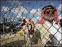 Man waits to cross from Egypt to Gaza