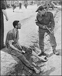 British soldier talking to an inmate at Belsen concentration camp, May 1945