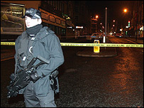 Armed police officer at shooting scene