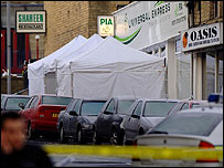 The scene of the shooting with a white tent