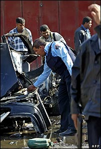 Police examine wreckage of car bomb in central Baghdad on Saturday