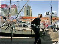 A Chinese elder looks at damage caused in last weekend's protests in Beijing April 13, 2005