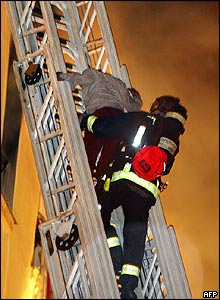 Fire fighter rescuing guest