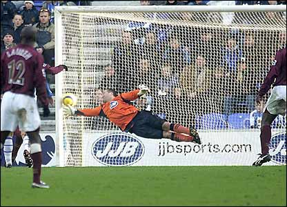 John Filan is beaten by Thierry Henry's free-kick