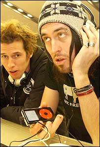 Men listening to digital music players
