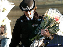 Police officer with flowers