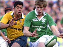 Irish debutant Andrew Trrimble attempts to evade  Morgan Turinui