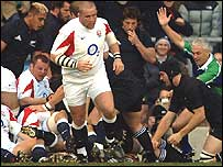 Referee Alan Lewis signals Martin Corry's early try for England