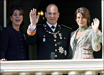 Princess Caroline, Prince Albert and Princess Stephanie wave to well-wishers during a military parade