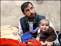 Qudratullah and father Hakim Gul Wardak in their refugee camp on 13 April